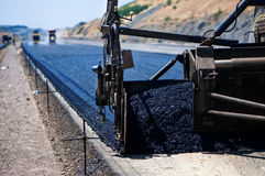Industrial pavement truck laying fresh asphalt Royalty Free Stock Image