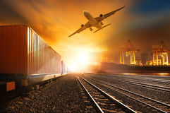 Industry container trainst running on railways track and commerc Royalty Free Stock Photos
