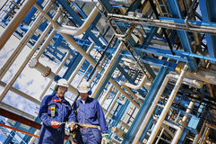 Industry workers inside oil and gas refinery Stock Images