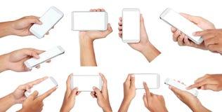 Insieme dello Smart Phone mobile della tenuta della mano con lo schermo in bianco Immagini Stock