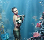 Inspiration. Fantastic Woman with Flowers in Water Stock Photos