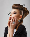 Inspiration. Gorgeous Caucasian Woman with Jewelry. Updo Hair Stock Images