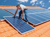 Installing alternative energy photovoltaic solar panels Stock Images