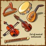 Instrumentos musicais da corda e do vento, seis ícones Fotos de Stock