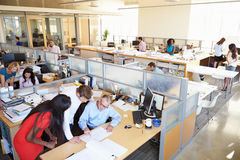 Interior Of Busy Modern Open Plan Office Stock Images