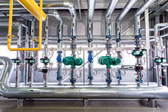 Interior of an industrial boiler, the piping, pumps and motors Royalty Free Stock Photos