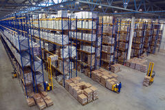 Interior large warehouse with freight stacked high. Stock Photos