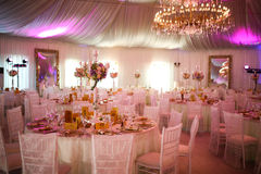 Interior of a luxury white wedding tent decoration ready for guests Royalty Free Stock Photos