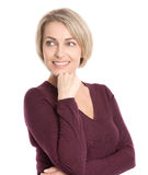 Isolated smiling middle aged woman in fall clothes looking sidew Royalty Free Stock Image