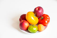 Isolated Still life with tomatoes and fruits Royalty Free Stock Photo