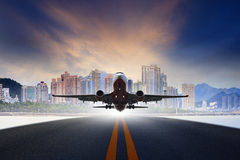 Jet plane take off from urban airport runways use for air transp Stock Image