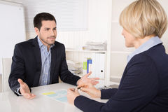 Job interview or meeting situation: business man and woman at de Stock Images