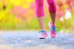 Jogging woman with athletic legs and running shoes Stock Image