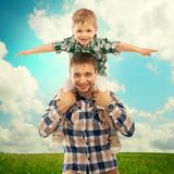 Joyful father with son on shoulders Royalty Free Stock Images