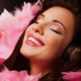 Inspiration. Fancy Cheerful and Happy Woman with pink Feathers smiling. Pleasure Royalty Free Stock Photo