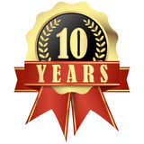 Jubilee button with banner and ribbons for 10 years Royalty Free Stock Images