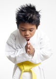Karate boy bowing Stock Photography