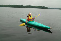 Kayak on Otter lake, Ontario, Canada. Royalty Free Stock Photography