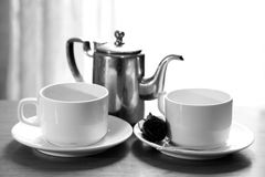 Kettle and tea cups Stock Photos