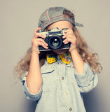 Kid with camera. Stock Photography