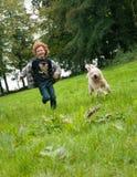 Kid and Dog running Royalty Free Stock Image