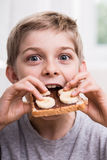 Kid eating with appetite Stock Photography