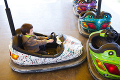 Kid in electric bumper car Royalty Free Stock Photo