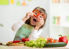 Kid girl having fun with food vegetables Stock Photos