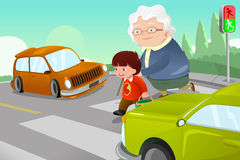 Kid helping senior lady crossing the street Stock Photography