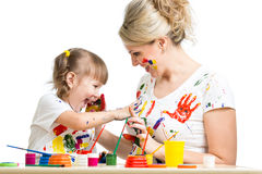 Kid with parent paint together Stock Photos