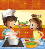 Kids cooking at the kitchen Stock Image