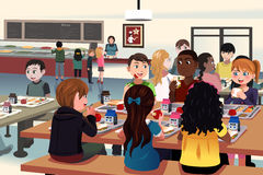 Kids eating at the school cafeteria Stock Images