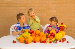 Kids and fruits Royalty Free Stock Images