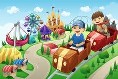 Kids having fun in an amusement park Royalty Free Stock Images