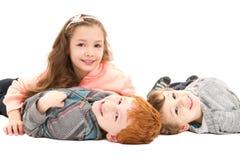 Kids having fun on floor Royalty Free Stock Photos