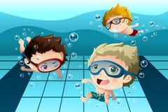 Kids having fun in the swimming pool Stock Photography
