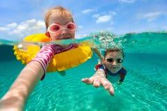 Kids having fun swimming on summer vacation Stock Image
