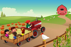 Kids on a hayride in a farm during Fall season Stock Image