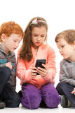 Kids looking at smartphone Stock Photography