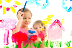 Kids painting picture on glass Stock Images