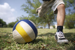 Kids playing soccer game, young boy hitting ball in park Stock Photos