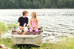Kids in punt - first kiss Royalty Free Stock Image