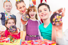 Kids showing muffin cakes at birthday party Royalty Free Stock Image
