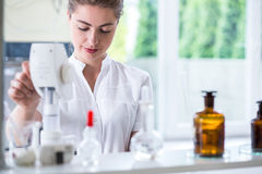 Lab technician doing chemistry experiment Royalty Free Stock Image