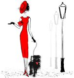 Lady with black dog Royalty Free Stock Photos