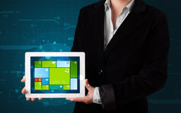 Lady holding tablet with modern software operational system Royalty Free Stock Photos