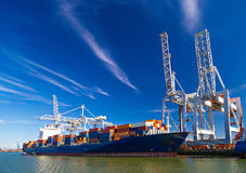 Large container vessel unloaded in Port of Rotterdam Stock Photos