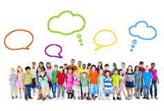 Large Group of Multiethnic Children With Speech Bubbles Stock Images