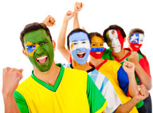 Latinamerican team with arms up Stock Photo