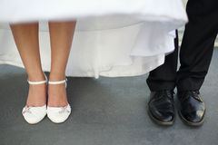 Leg and shoes of wedding couple Stock Images
